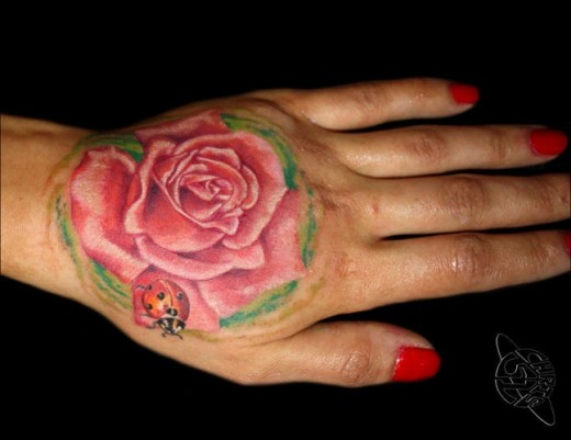 30 outstanding back hand tattoo designs for girls sheplanet for Female hand tattoos