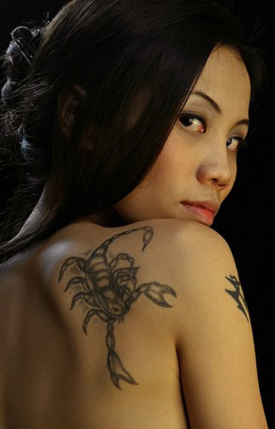 busty-girl-with-scorpion-tattoo