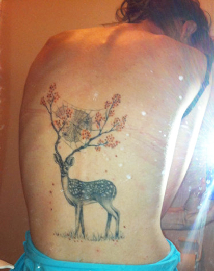 33 awesome deer tattoo designs sheplanet for Hot female back tattoos