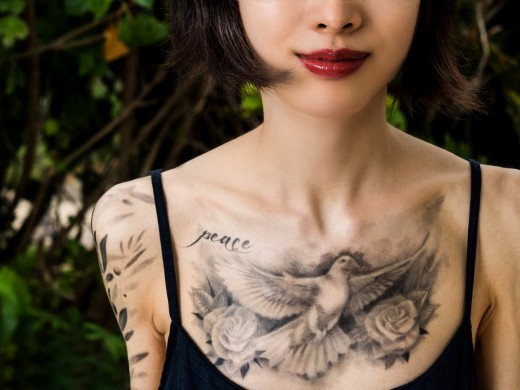 20 stunning dove tattoo designs sheplanet for Chest tattoos for women designs